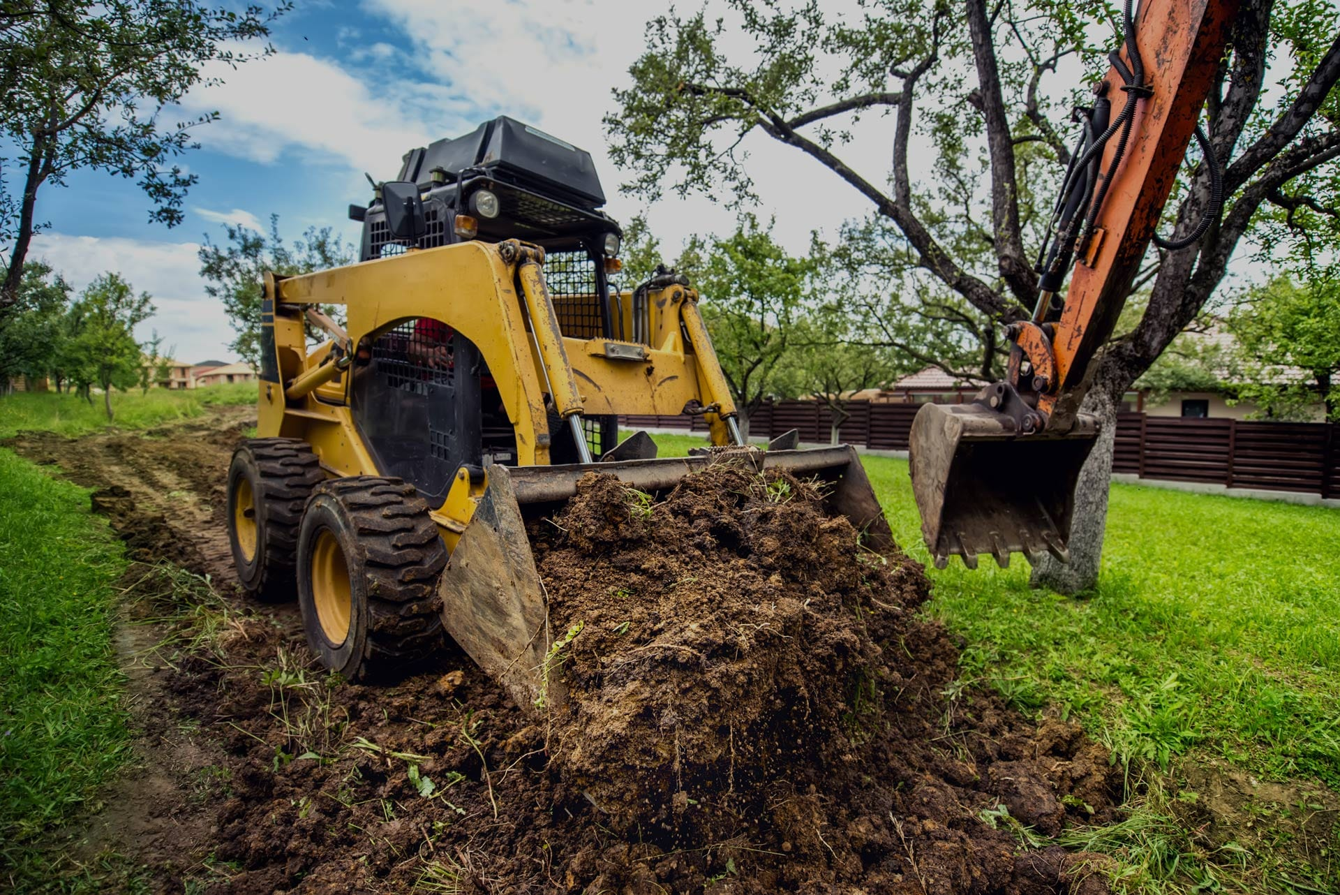 High resolution picture of a Bobcat 4-tonne excavator digging an open field in Corrimal, NSW